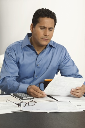 45 to 50 year olds: Man Doing Personal Finances LANG_EVOIMAGES