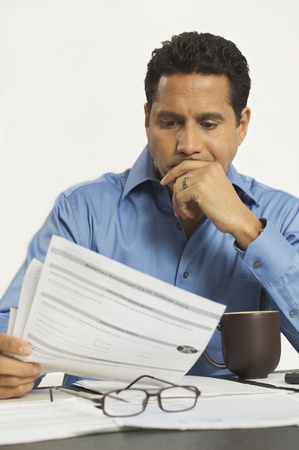 Man Reading a Tax Form Stock Photo - 12548384