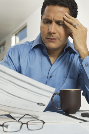 maladies: Man Doing Taxes LANG_EVOIMAGES