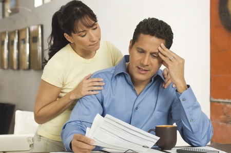 45 to 50 years old: Couple Discussing Finances