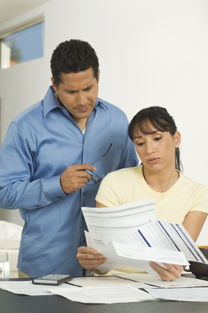 Couple Discussing Bills Stock Photo - 12548387