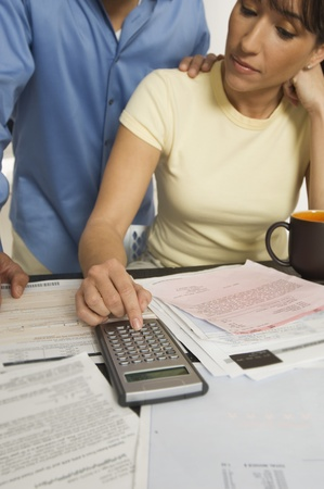figuring: Couple Figuring out Bills