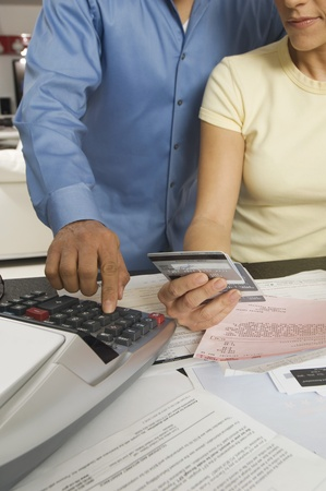 cropped off: Couple Calculating Bills LANG_EVOIMAGES
