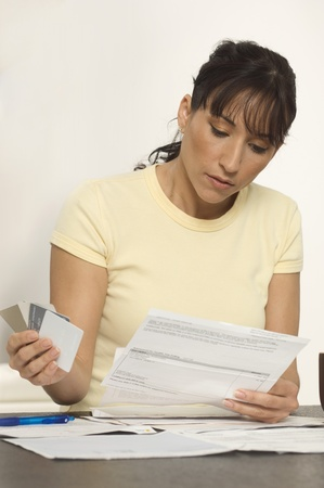 figuring: Woman Figuring out Bills