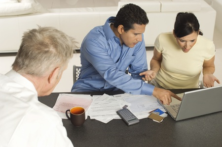 Accountant Working with Couple Stock Photo - 12548402