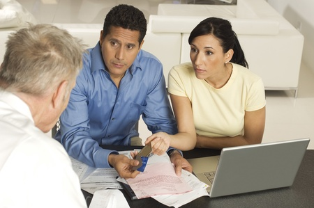 30 to 35 year olds: Businessman Assisting Couple with Credit Cards
