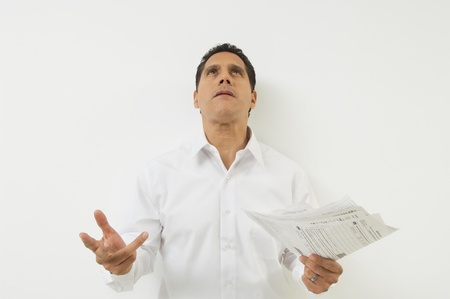 Man Frustrated with Taxes Stock Photo - 12548422