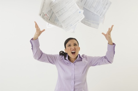 exasperation: Woman Tossing Forms in the Air LANG_EVOIMAGES