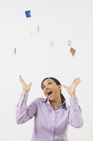 upper half: Woman Tossing Credit Cards in the Air
