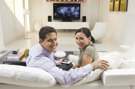 50 to 55 years old: Couple Watching TV