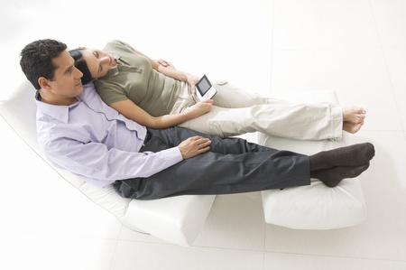 45 to 50 year olds: Couple Watching Portable TV
