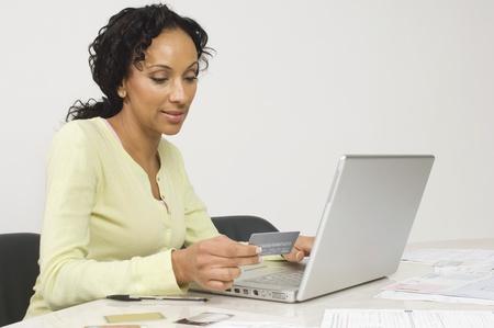Woman Doing an Online Transaction Stock Photo - 12548447