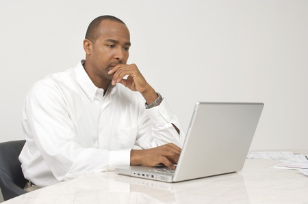 Man Using a Laptop Stock Photo - 12548449