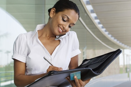 Young Woman Writing in a Planner Stock Photo - 12548484