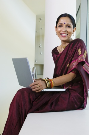Woman Using a Laptop Stock Photo - 12548490