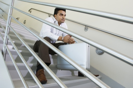 being the case: Businessman Sitting on a Stairway LANG_EVOIMAGES