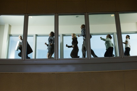 chased: Businesspeople Running down Hallway