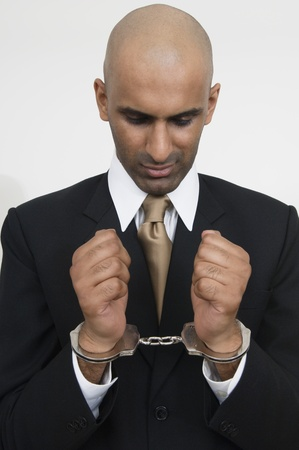enforcing the law: Businessman in Handcuffs LANG_EVOIMAGES