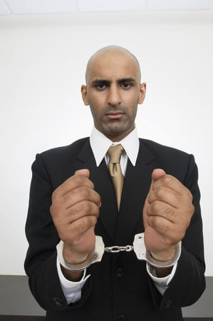 Businessman in Handcuffs Stock Photo - 12548501