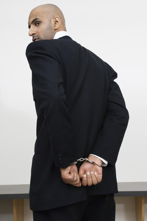 Businessman in Handcuffs Stock Photo - 12548503