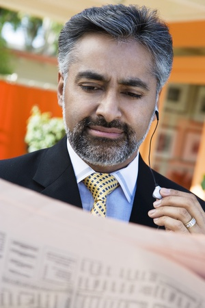 40 to 45 year olds: Businessman Reading a Newspaper