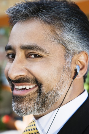 35 40 years old: Businessman with an Earbud