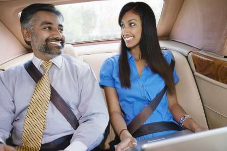 Businesspeople Using Laptop in Car Stock Photo - 12548514