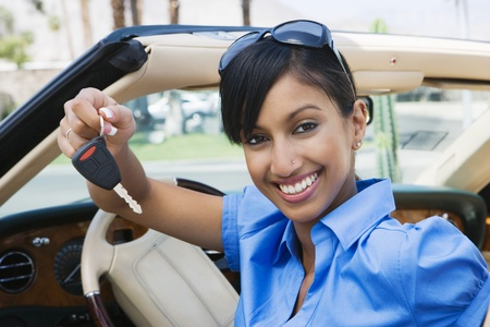 Young Woman Holding Key to Convertible Stock Photo - 12548519