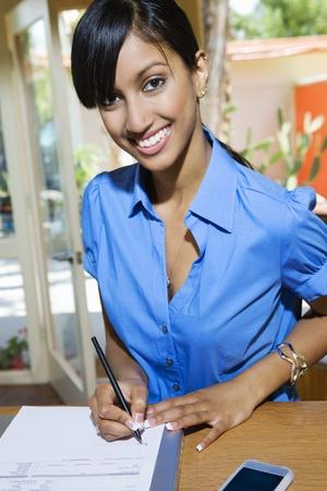 reciept: Woman Signing Paper