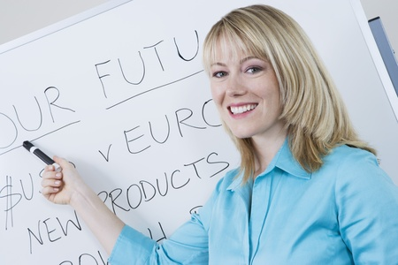 Businesswoman Presenting Company Goals Stock Photo - 12548544