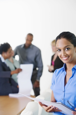 racially diverse: Businesswoman in Meeting LANG_EVOIMAGES
