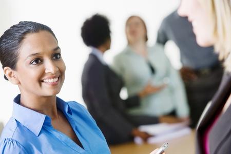 ethnically diverse: Businesswomen Talking LANG_EVOIMAGES