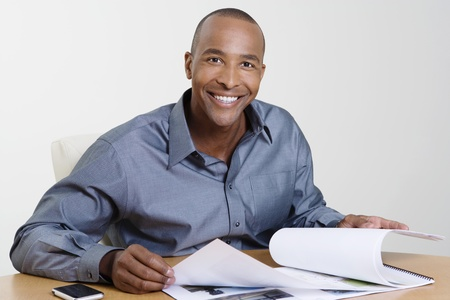 Man Looking at Booklet Stock Photo - 12592334