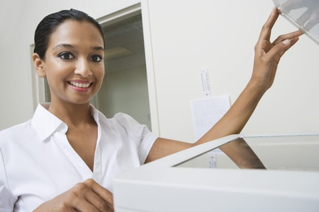 Woman Using Photocopier Stock Photo - 12592339