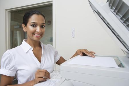 Woman Using Photocopier Stock Photo - 12592340