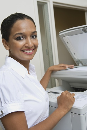 Businesswoman Using Photocopier Stock Photo - 12592341