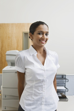 20 to 25 year olds: Businesswoman Standing by Photocopier LANG_EVOIMAGES