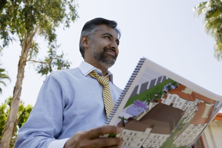 45 to 50 year olds: Architect Holding Book with Building Plans