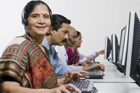 Customer Service Reps in Call Center Stock Photo - 12592360