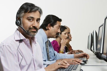Customer Service Reps in Call Center Stock Photo - 12592361