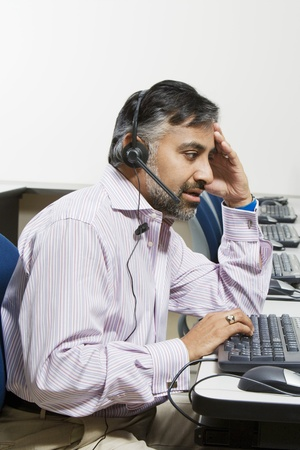 45 to 50 years old: Businessman Using Telephone Headset