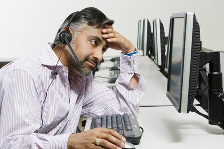 Frustrated Customer Service Representative Stock Photo - 12592368