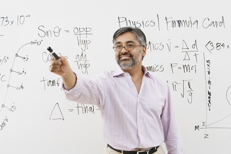 Teacher in Front of Whiteboard Stock Photo - 12592379
