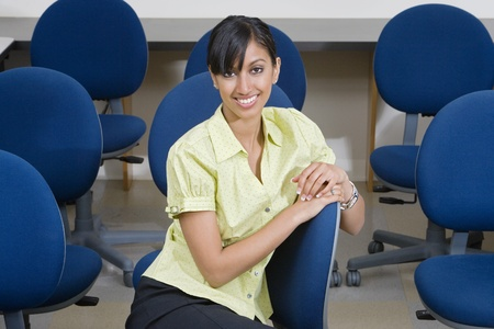 Young Businesswoman Sitting in Chair Stock Photo - 12592388