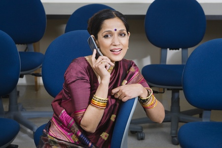 Indian Businesswoman Using Cell Phone Stock Photo - 12592390
