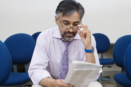 age 50 55 years: Businessman Reading Newspaper