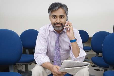 one mature man only: Businessman Using Cell Phone