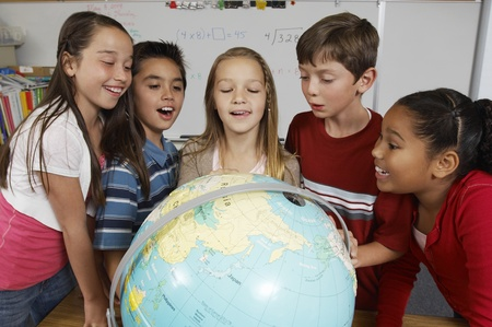 Group of pupils looking at globe Stock Photo - 12592404