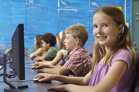 School children using computers in classroom Stock Photo - 12592472