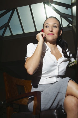 low blouse: Young business woman on the phone